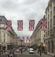 Union Jacks fly between buildings over the streets in Piccadilly Circus