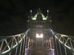 One of the towers of London Bridge lit up at night