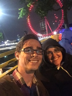 My aunt and I on a bus tour through London with the London Eye lit in red