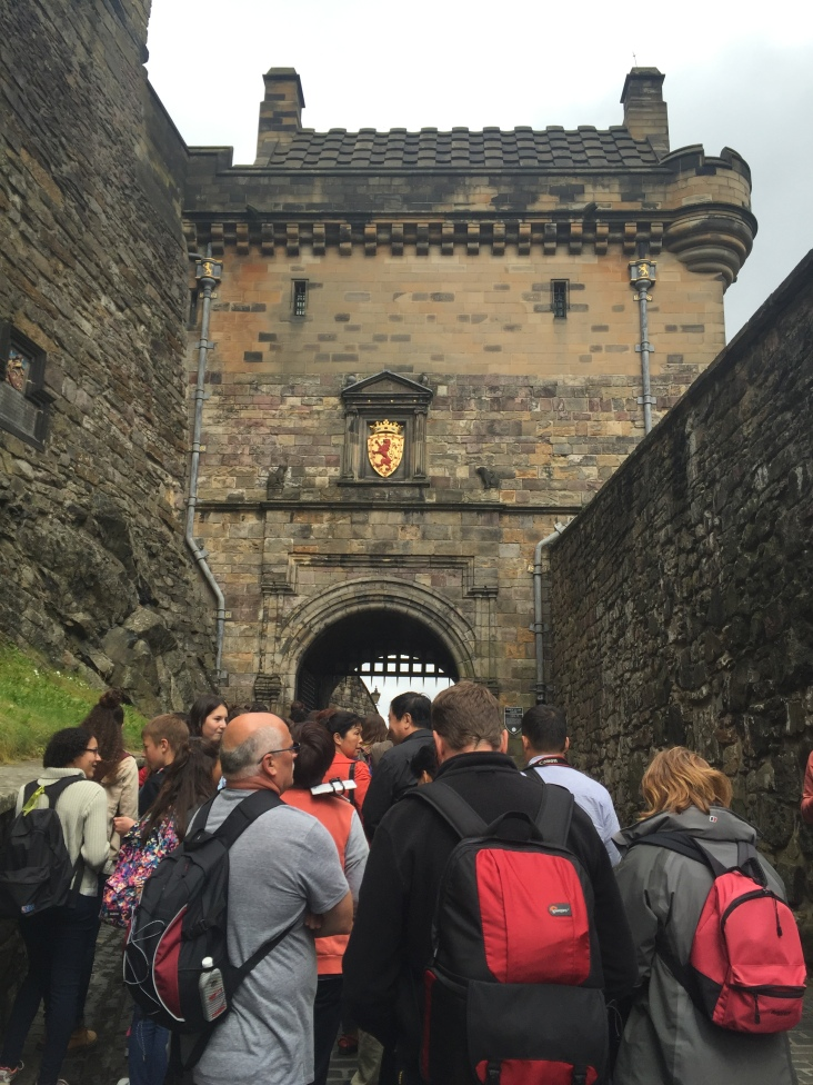 Tourists crowd the path leading under the gatehouse into Edinburgh Castle