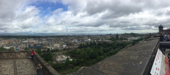 Children view the city of Edinburgh from the ramparts of the castle