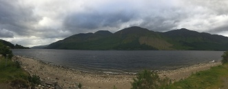 Loch Ness with mountains rising above in the background