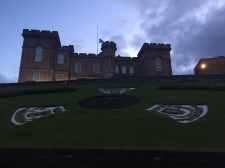 Well maintained landscaping on the hillside surrounding Inverness Castle at dusk