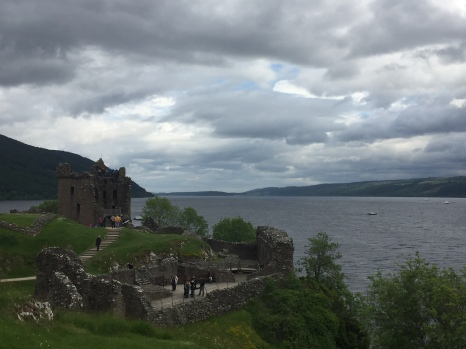 The keep of Urquhart Castle sits on a hill on the edge of Loch Ness