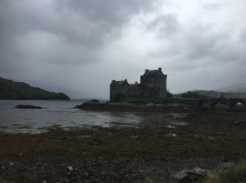 Eilean Donan Castle sits in a murky bay on a rainy day