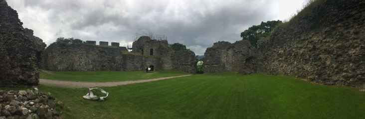 The courtyard of Inverlochy Castle surrounded by crumbling walls