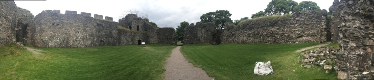 A pathway leading through the courtyard in Inverlochy Castle leading to a ruined gate