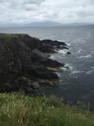 Rugged cliffs tumble into the sea on the Irish coast