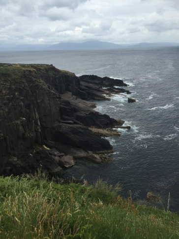 Rugged cliffs tumble into the sea on the Irish coast