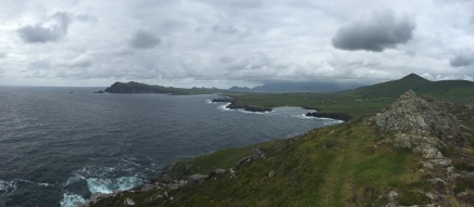 The rugged Irish coastline on the stretches into the distance and disappears into the haze