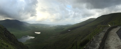 The valley below Conor pass stretches far and away below a panoramic viewpoint