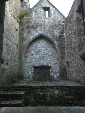 The interior of an unmarked room of the Ardfert Cathedral. Possibly a mausoleum or tomb.