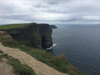 The cliffs of Moher and the trail that leads alongside and close to the edge