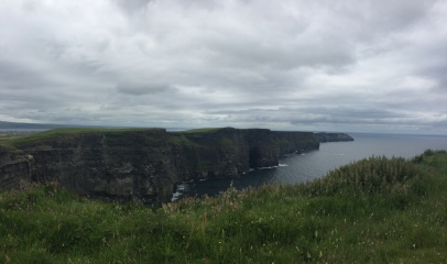 The Cliffs of Moher stretch into the distance over the ocean far below
