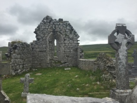 The remains of an abandoned stone chapel and graveyard in the countryside of Ireland