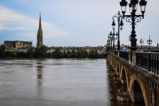 The river, bridge, cathedral, and spire in Bordeaux