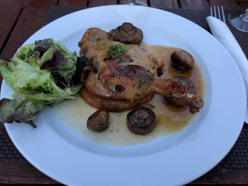 Duck confit with mushrooms, potatoes, and salad