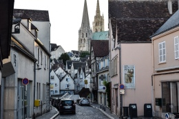 A street in Chartres showing a mixture of architecture and the cathedral at the top of the hill