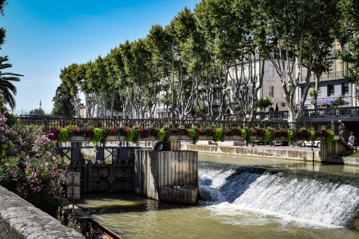 The flower lined passerelle over the lock system of the Canal de la Robine in Narbonne