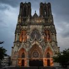 The facade of the Reims Cathedral at dusk