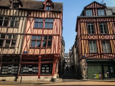 Row of medieval half-timbered houses lining the streets of Rouen in Normandy