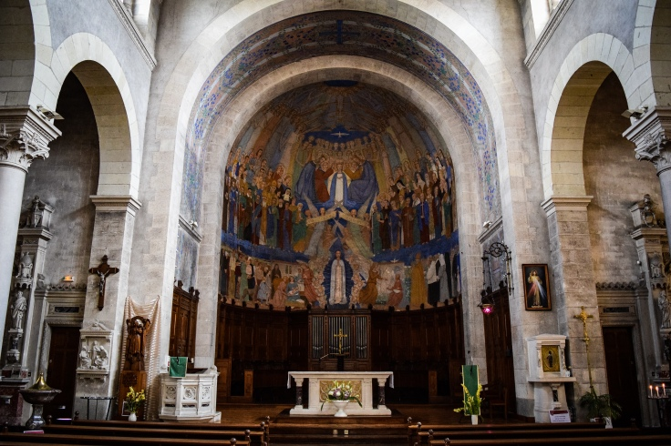 The religious murals painted on the ceiling inside the Eglise Notre-Dame in Clisson