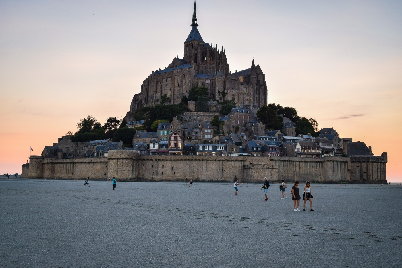 The island of Mont Saint Michel during low tide at sunset