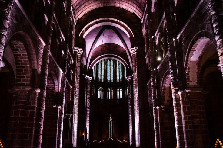 Inside the abbey of Mont Saint Michel during the nighttime lit tour